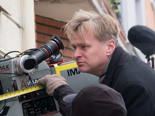 Christopher Nolan looks into the IMAX camera on the
