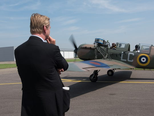 Christopher Nolan gets ready for takeoff while filming