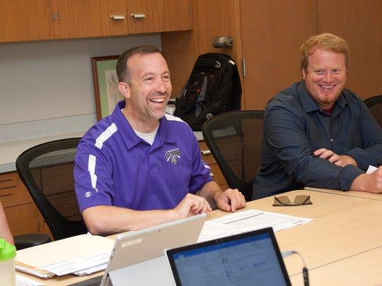 New Lakeview Superintendent Blake Prewitt, left, laughs at a joke made during a recent meeting.