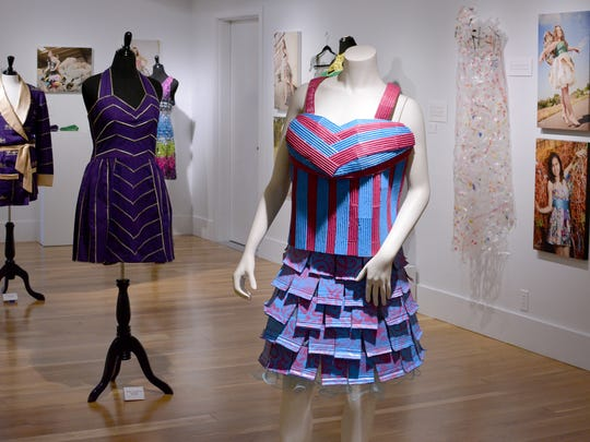 """""""Upcycle Fashion"""" is an exhibition at Bush Barn Art Center through Aug. 26 showcasing garments created from repurposed, disposable materials includingcardboard, steel/tin, recycled fabric or clothing, plastics, newspaper and paper bags."""