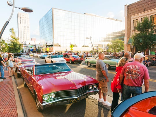 People and cars crowded downtown Battle Creek Saturday evening for Cruise the Gut