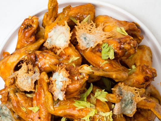 The secret to this wing pile is those crispy Parmesan/bleu cheese tuilles