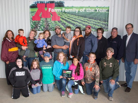 University of Extension Dean Bev Durgan (back, left) with Stearns County's 2017 Farm Family of the Year, Greg and Audrey Rademacher family of Brooten