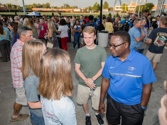 Middle Tennessee State University President Sidney A. McPhee, right, chats with guests during the President's Picnic held Saturday, Aug. 26, near Floyd Stadium following Convocation.