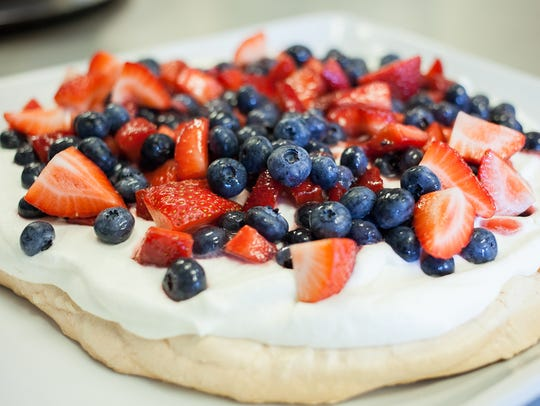 Heaping strawberries and blueberries is one way to