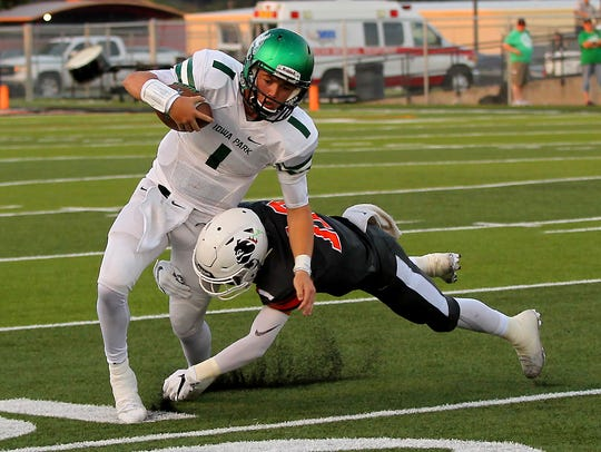 Iowa Park's Trent Green is tackled by a Burkburnett