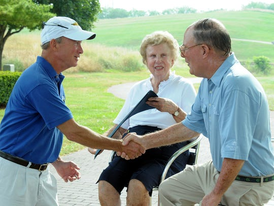 Gov. Mitch Daniels shakes hands with Pete Dye after presenting him and his wife, Alice, with Sagamore of the Wabash awards during Thursday's announcement of the Pete Dye Golf Trail.""