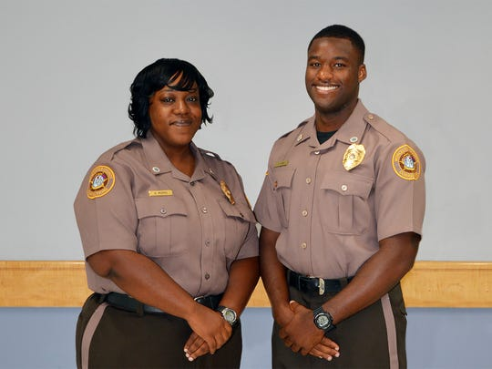 Officers from the Worcester County Jail and Detention Center who graduated in the 99th entrance-level class of the Eastern Shore Criminal Justice Academy operated by Wor-Wic Community College in Salisbury are shown, from left, Angela J. Morris and Teron C. Tyre.