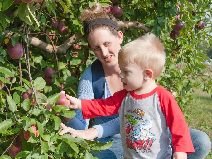 Jessica Wood helps Carson Stone, 18 months, pick an