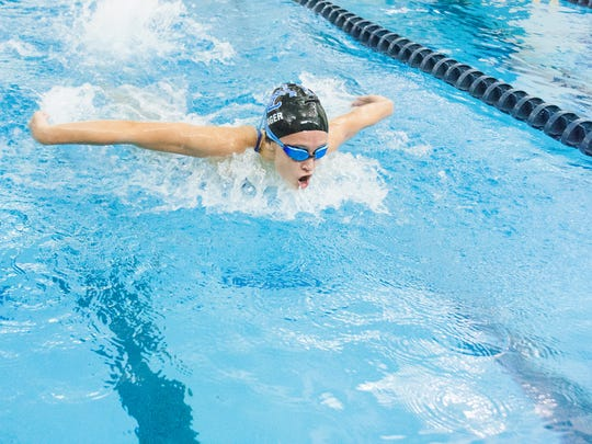 Harper Creek Sophomore Alysa Wager races in the 100 Yard Butterfly