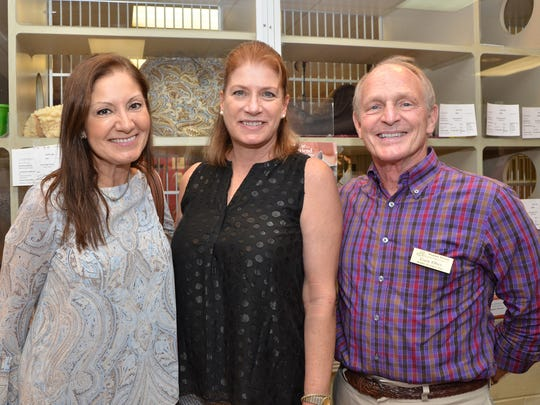 "Paulina Alvayay and HSTC board members Cindi Hobbs and Gary Ober attend the Humane Society of the Treasure Coast's inaugural ""Kitty Catalina Wine Mixer"" to benefit the shelter animals."