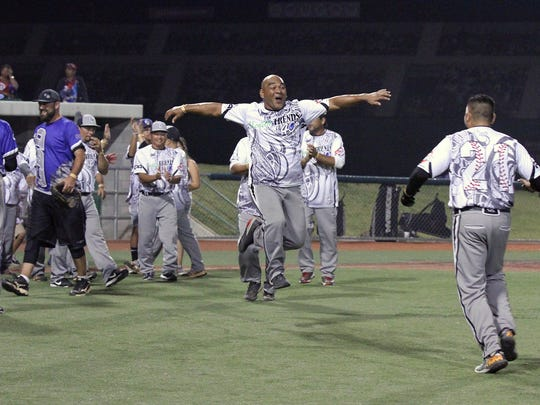 Bud Light Guam's Benjie Pangelinan, center, reacts after Tony Yatar (21, right) slammed a three-run home run in the bottom of the last inning, giving Guam a 23-21 thriller over Color By Design (Maryland) Oct. 7, 2017, in the 2017 LVSSA/SSUSA World Masters Softball Championship Men's 40-Over AAA Division in Las Vegas. The victory moved Guam into a key bracket seeding en route to the overall championship.