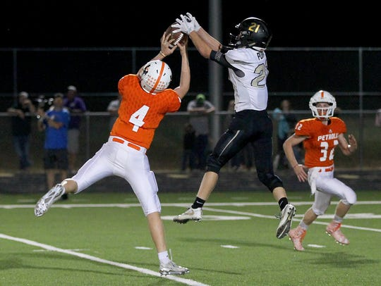 Petrolia's Colby Kowalick (4) intercepts the Quanah