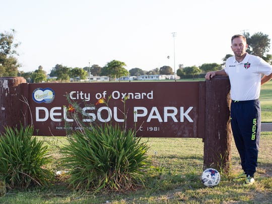 Ross Greaney poses at Del Sol Park in Oxnard after being hired as head coach of the Oxnard Guerreros FC, who play their home games at Del Sol Stadium.