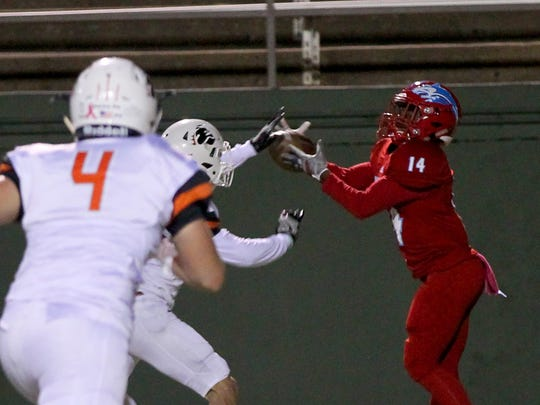 Hirschi's Tian Harrell makes the catch for a touchdown against Burkburnett Friday night at Memorial Stadium.