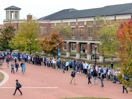 MTSU led a campus-wide event — Hands Across MTSU — to publicly embrace all members of the Blue Raider community. on Monday, students, faculty, staff, alumni and supporters across campus joined hands to form a human chain 'to promote unity and solidarity.'