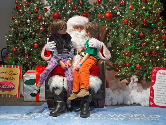 Santa listens to Christmas wish lists at Discovery World.