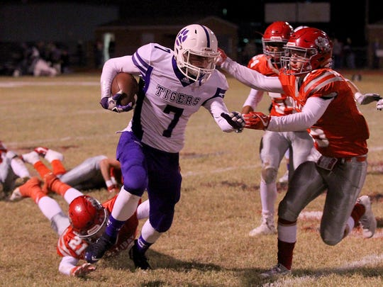 Jacksboro's Ty Kennedy tries to break through the Holliday defense Friday night in Holliday as the Eagles hosted the Tigers in Friday night action.