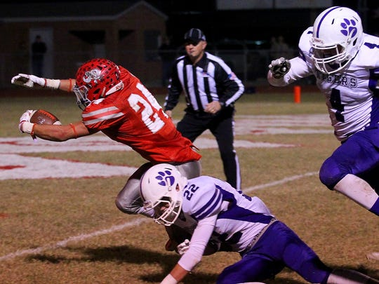 Hollidays's Tristin Boyd dives for the touchdown Friday night in Holliday as the Eagles hosted the Tigers in Friday night action.
