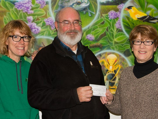 Wendy Lutzke (from left), environmental educator and butterfly garden coordinator, and Jim Knickelbine, executive director of Woodland Dunes Nature Center, and Linda Brandel from the Manitowoc County Master Gardener Volunteers. The Master Gardener Volunteers donated $500 to Woodland Dunes.