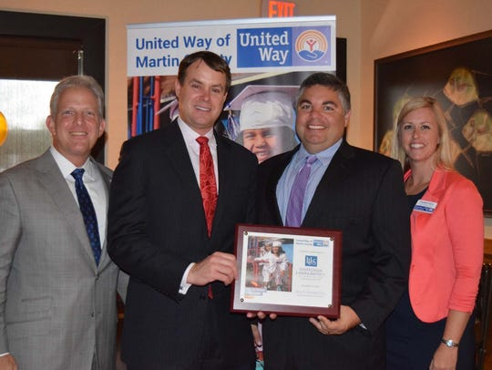 Gary Lesser, Chad Hastings, Josh Ferraro, and Elisabeth Glynn acknowledge Lesser, Lesser, Landy and Smith's contribution to United Way.