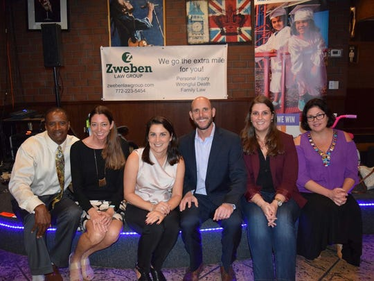 For the fourth year in a row, Zweben Law Group is spearheading the Zweben Bike Drive to benefit United Way's White Doves Holiday Project.From left are Xavier Blatch, Shari McGlynn, Tara Zweben, Gene Zweben, Kristen Bishop, and Rhonda Havard.