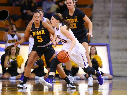 UNI's Ellie Howell looks to drive the ball against