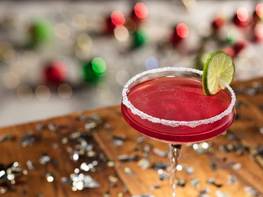 Olive Garden's Merry Cranberry is a holiday cocktail featuring cranberry vodka and amaretto shaken with cranberry-pomegranate juice.
