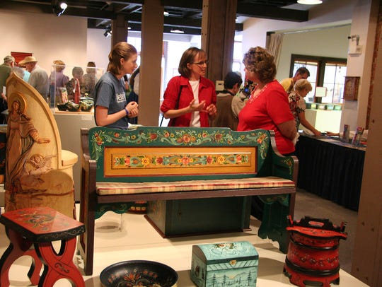 Visitors to the Vesterheim Museum in Decorah examine