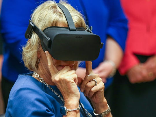 U.S. Department of Education Secretary Betsy DeVos tries on virtual reality goggles during her visit to Hope Academy recovery school in Indianapolis, Friday, Sept. 15, 2017. DeVos made stops in Gary and Indianapolis as part of her Rethink School tour.