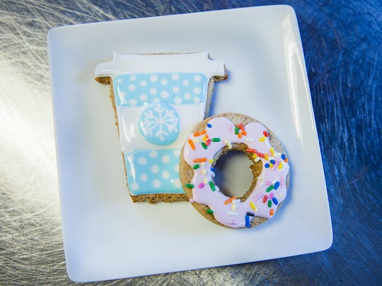 A holiday cup cozies up to a doughnut-shaped cookie by Katherine Hood. Hood is a culinary arts student at Rowan College at Burlington County.