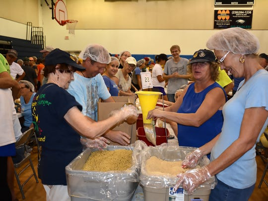 File: Nov. 15, 2015, Catherine Thonig, left, Matt Basler, Susan Ackerson, and Diane Chestnut work together to bag up meals at Charter Middle, approximately 500 Meals of Hope volunteers packed over 425,000 meals to feed the hungry in Southwest Florida.
