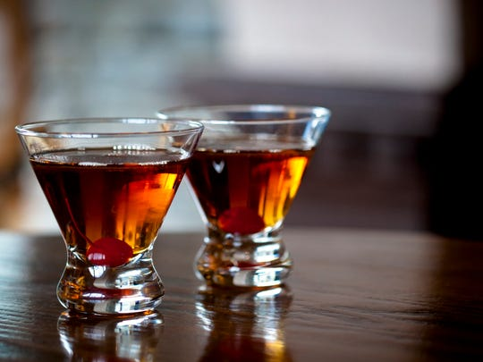 Substitute liquors to make a different Manhattan.
