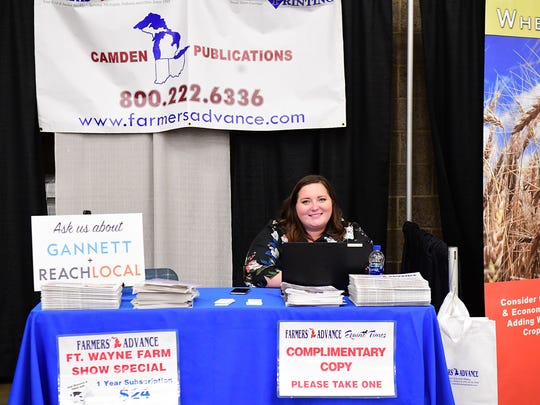 Heather Van Lieu, multi media representative for Farmers' Advance and Equine Times staffs the Camden Publications booth on Tuesday at the 2018 Fort Wayne Farm Show.