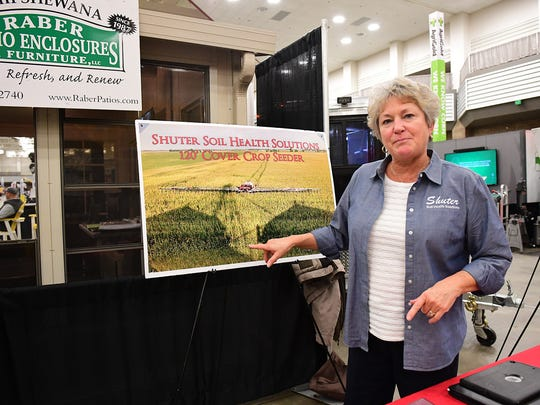 The Shuter Soil Health Solutions representative explained their cover crop seeder during the Farm Show. The seeder allows a cover crop to be over seeded onto an existing corn field. After the corn is harvested the cover crop takes over to hold the soil. Shuter Soil Health Solutions is located in Frankton, IN.