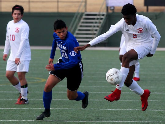 Hirschi's Shaughnessy Emanuel controls the ball during