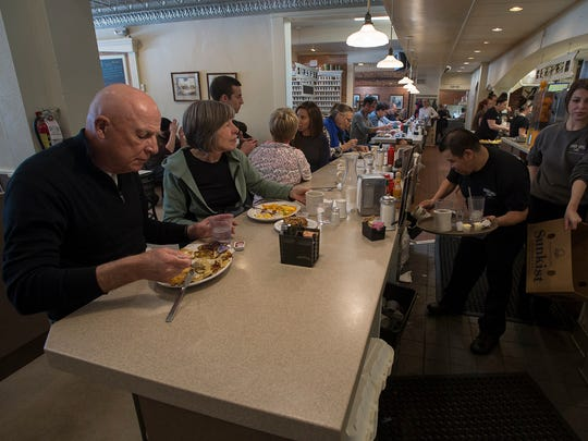 Bob and Tracy Vangermeersch, left, eat their brunch at diner bar on Saturday, Feb. 24, 2018, at the Silver Grill Cafe in Old Town Fort Collins, Colo.