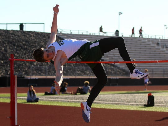 Iowa Park's Gavin Worley clears the bar in the high