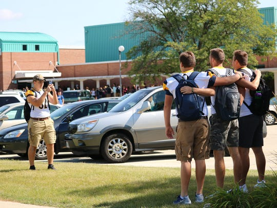 Whitnall High School students pose to have their picture