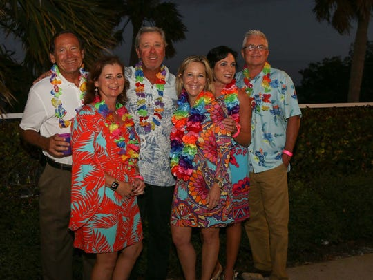 Tom Whittington, left, Sue Whittington, Bob Brunjes, Amy Brunjes, Lisa Baxter and Rick Baxter at United Way of Martin County's inaugural Tikis on the Terrace.