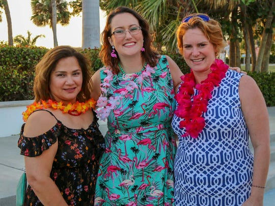 United Way of Martin County's inaugural Tikis on the Terrace brought smiles to the faces of Jennie Carcamo-Julbe, left, Sarah Baker and Donna DeMarchi.