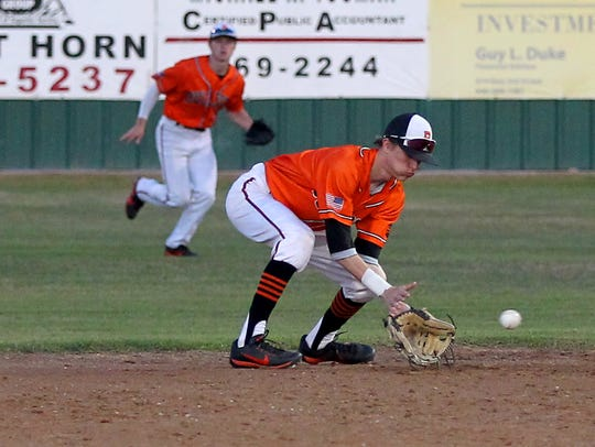 Burkburnett's Garrett Mooney fields a grounder Tuesday