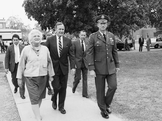 In this Aug. 29, 1988, file photo, Vice President George H.W. Bush and wife Barbara Bush walk with Lt. Col. Cal Calloway, far right, MTSU Military Science chair, and then Middle Tennessee State University President Sam Ingram, second from right in back, from a parking lot toward the campus ROTC building for a briefing and display. The Bushes were visiting MTSU as part of a fundraising trip to Nashville during the presidential campaign. (MTSU photo by Jack Ross)