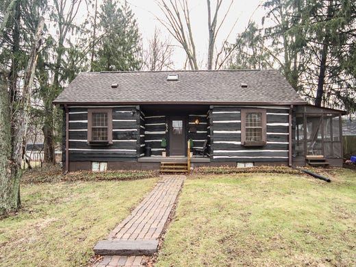 Log cabin and converted barn with flair for sale in Zionsville