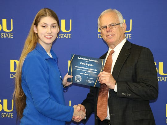 Kayla Kappler, a DSU Champion Scholar, is pictured with Bob Preloger, interim vice president of Institutional Advancement at DSU.