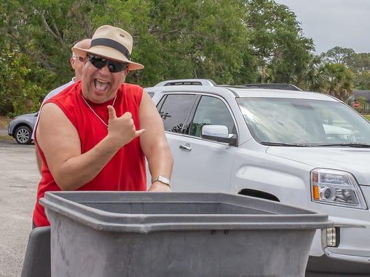 Volunteer Jorge Carreras is all smiles as he helps