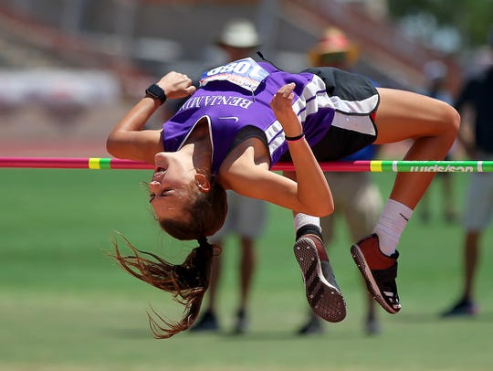 Macy Flowers clears the bar in the girls 1A high jump