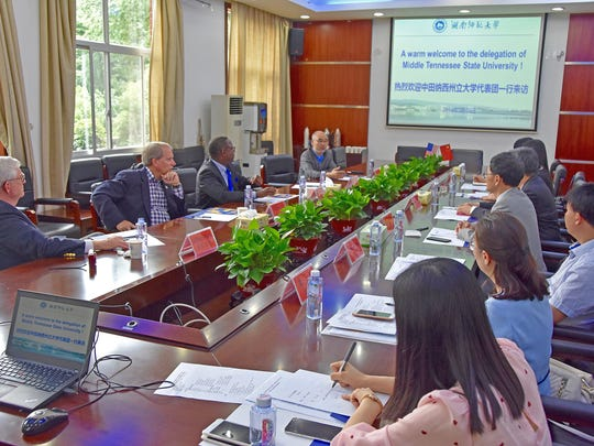 MTSU Associate Vice Provost Guanping Zheng, top right, makes a point during MTSU's discussions about international enrollment with officials from Hunan Normal University in Changsha, China, on Tuesday, May 15. MTSU President Sidney A. McPhee, left of Zheng, along with state Sen. Bill Ketron, left of McPhee, and MTSU donor Paul Martin, left of Ketron, also participated. MTSU and HNU have been partners since 2004.
