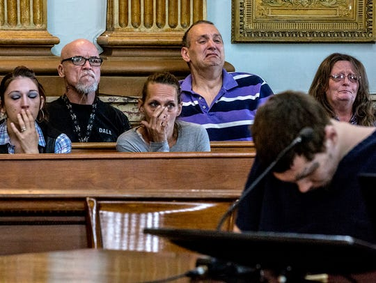 The family of David Earl Barcus listen during the plea