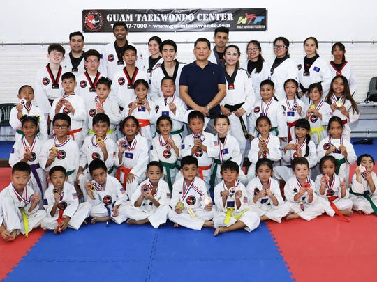 Medalists with Master Noly Caluag, center, during the recent 2018 Master Noly's Taekwondo Sparring Tournament.